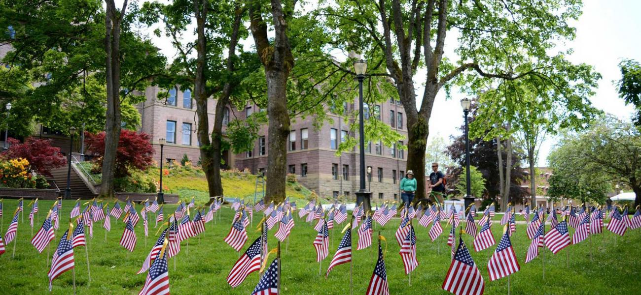 Old main lawn with rows of small American flags lined up in the grass